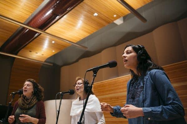 Nila Bala, Rachel LaViola, and Sarah Larsson sing as the Nightingale Trio