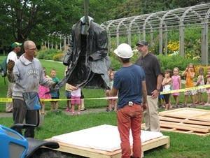Kids watch sculpture removal