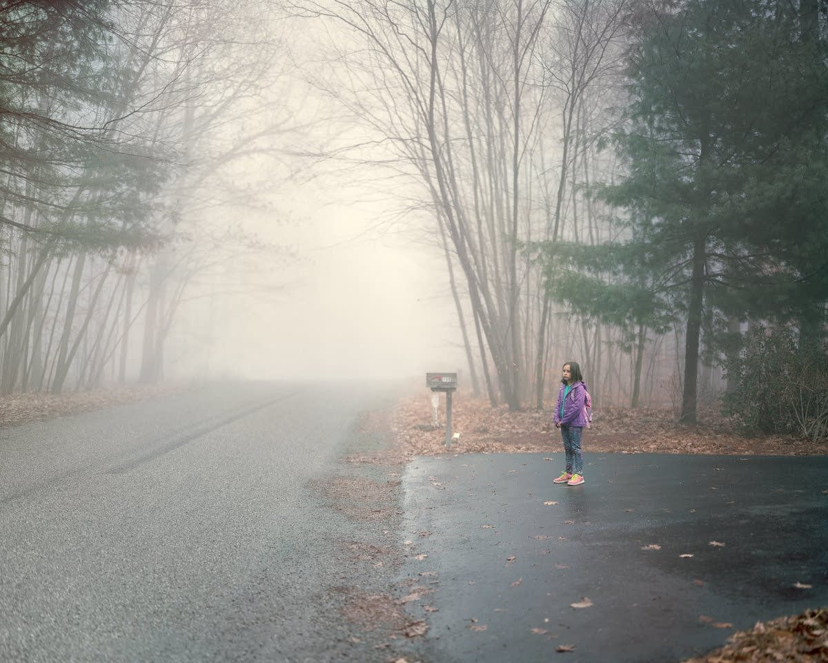 Photographer Greg Miller's daughter waits for her morning bus.