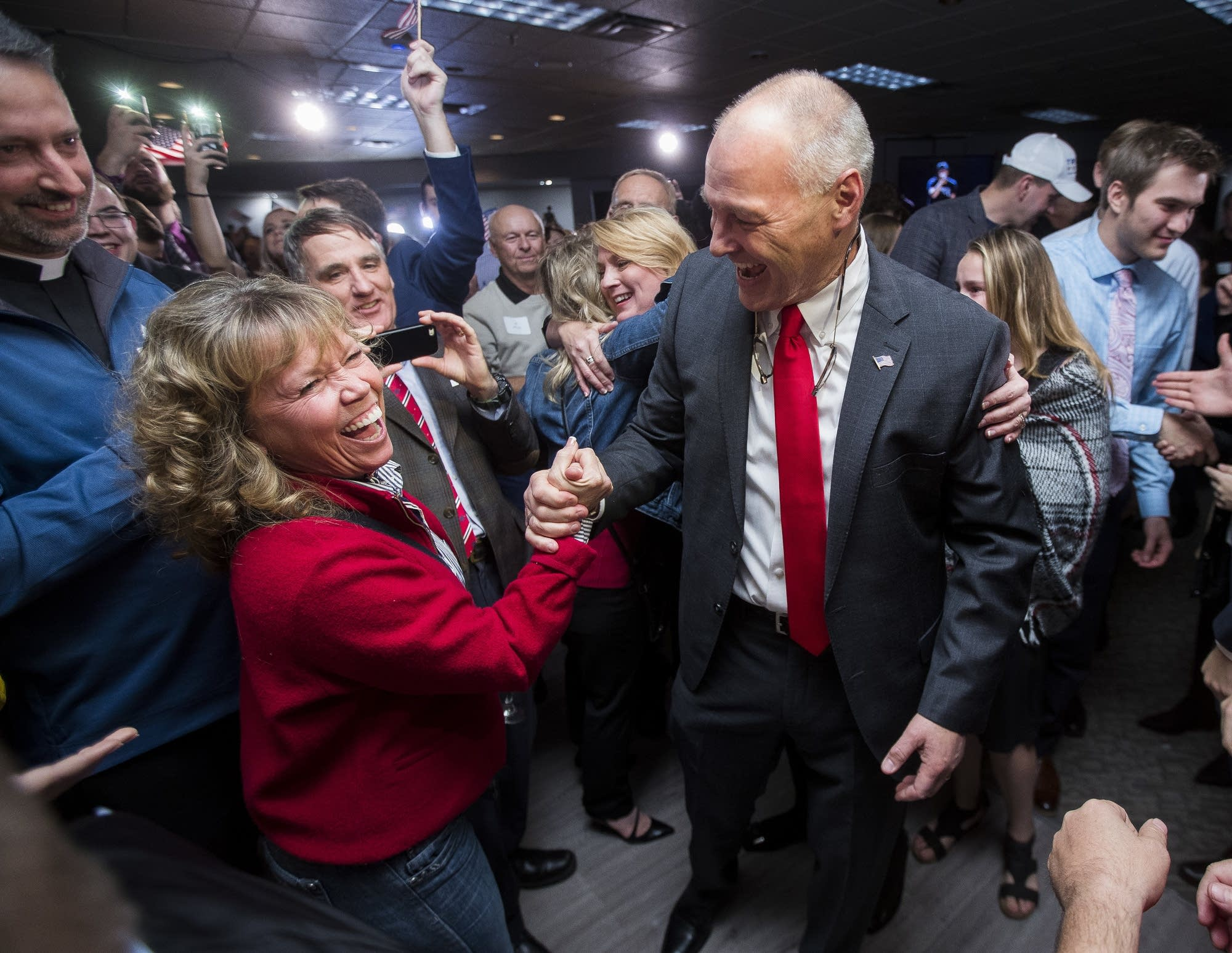 Pete Stauber, 8th District Rep. candidate, celebrates with supporters.