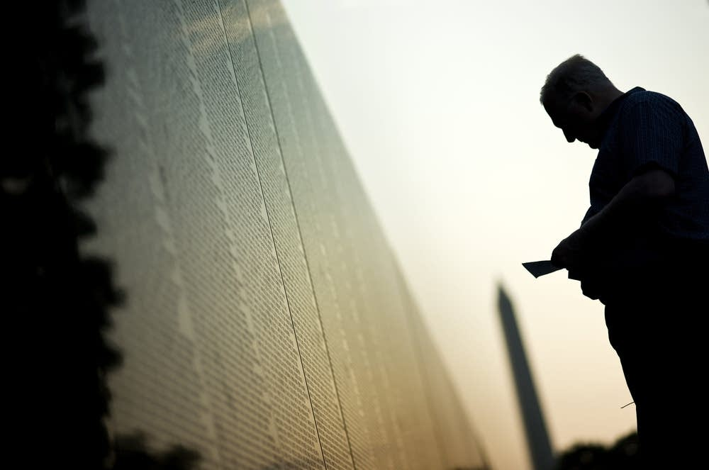 A man visits the Vietnam Memorial Wall M