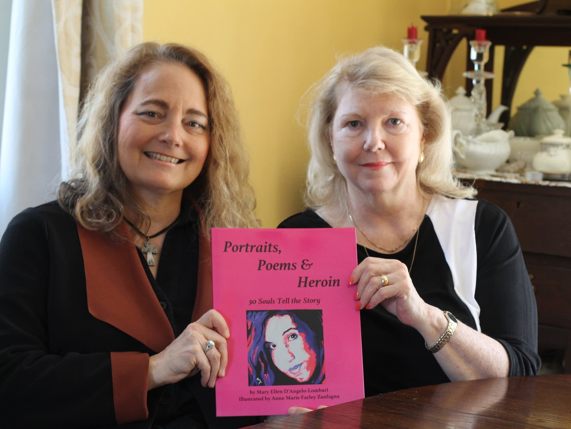 Poet Mary Ellen D'Angelo-Lombardi (left) and artist Anne Marie Zanfagna