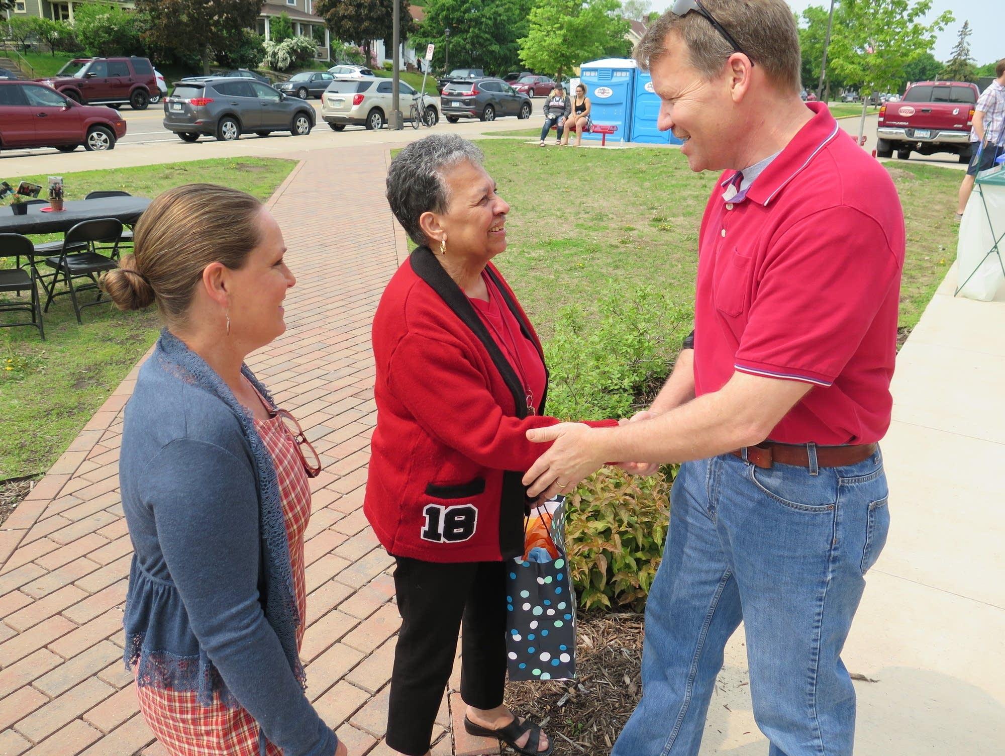 Jeff and Dawn Pauls congratulate St. Paul Central Principal Mary Mackbee
