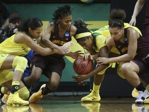 Oregon and Minnesota players scramble for a loose ball.