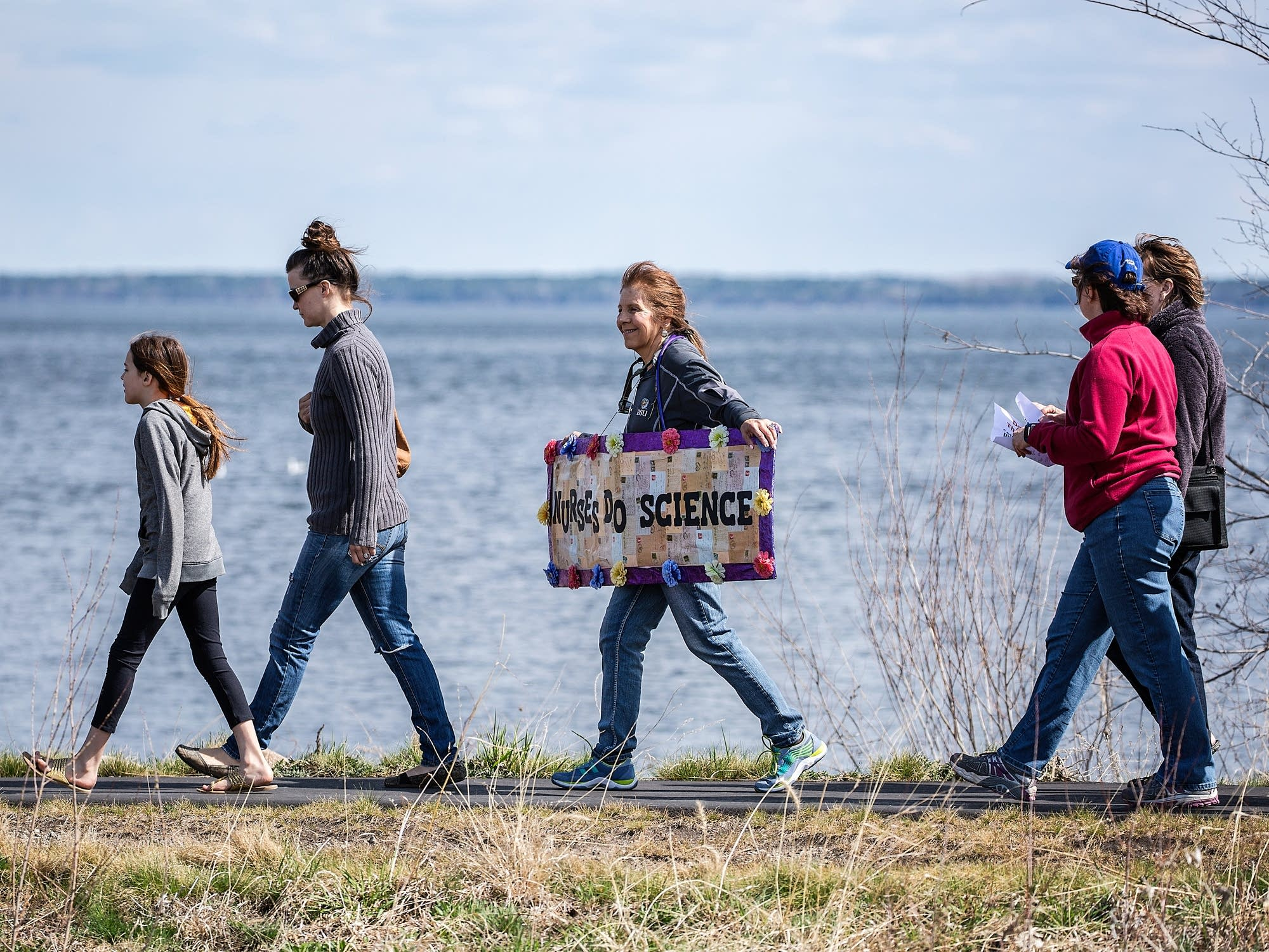The march stretches along the shores of Lake Bemidji.