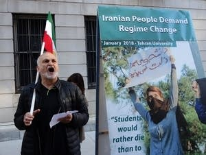 Protesters against Iranian Foreign Affairs Minister Mohammad Zarif