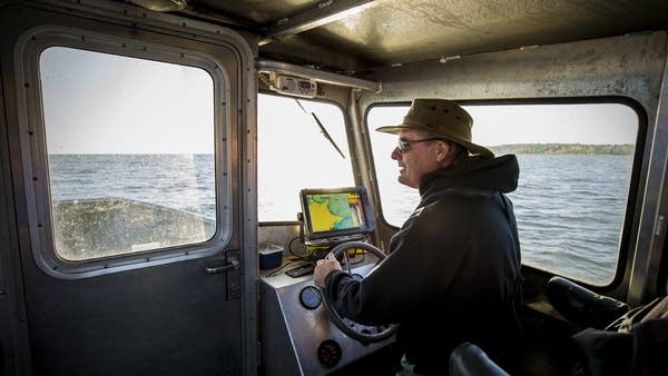 Tom Jones navigates the waters of Mille Lacs searching for DNR nets.