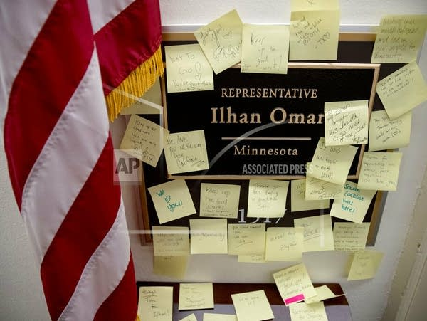 People leave post-it notes of support outside Rep. Ilhan Omar's office