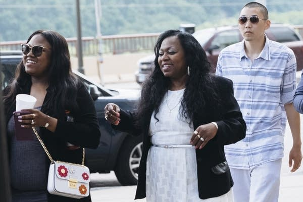 Allysza Castile, left, and Valerie Castile, center, leave the courthouse.