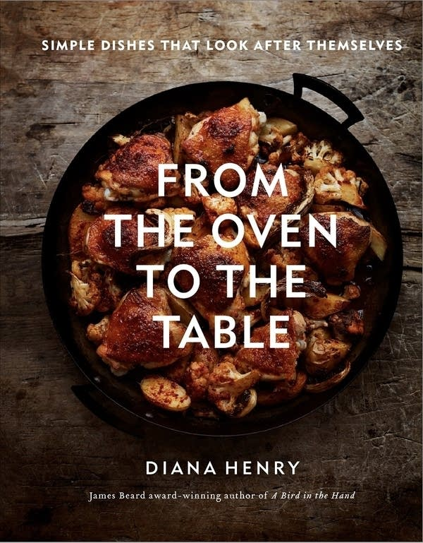 book cover with cast iron pan of chicken thighs, cauliflower and potatoes