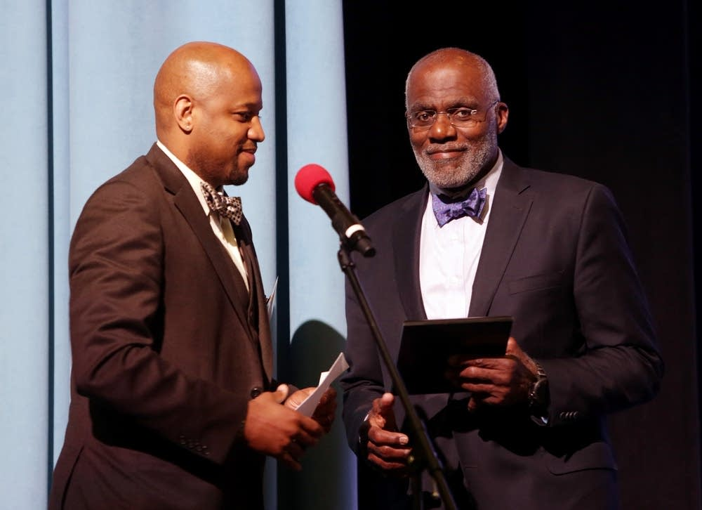 Alan Page, right, receives an honor for his service