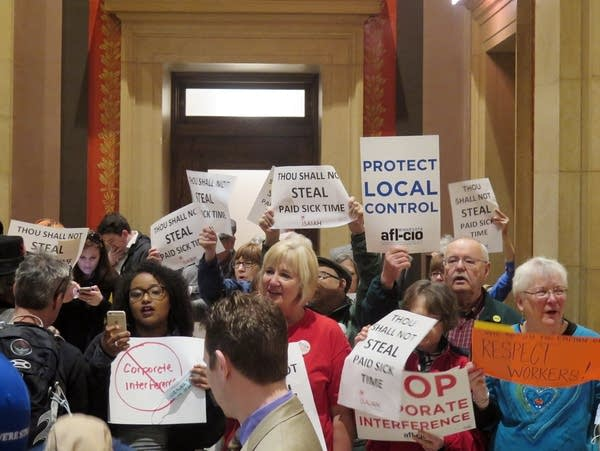 Protesters waved signs and chanted outside the Senate chamber.
