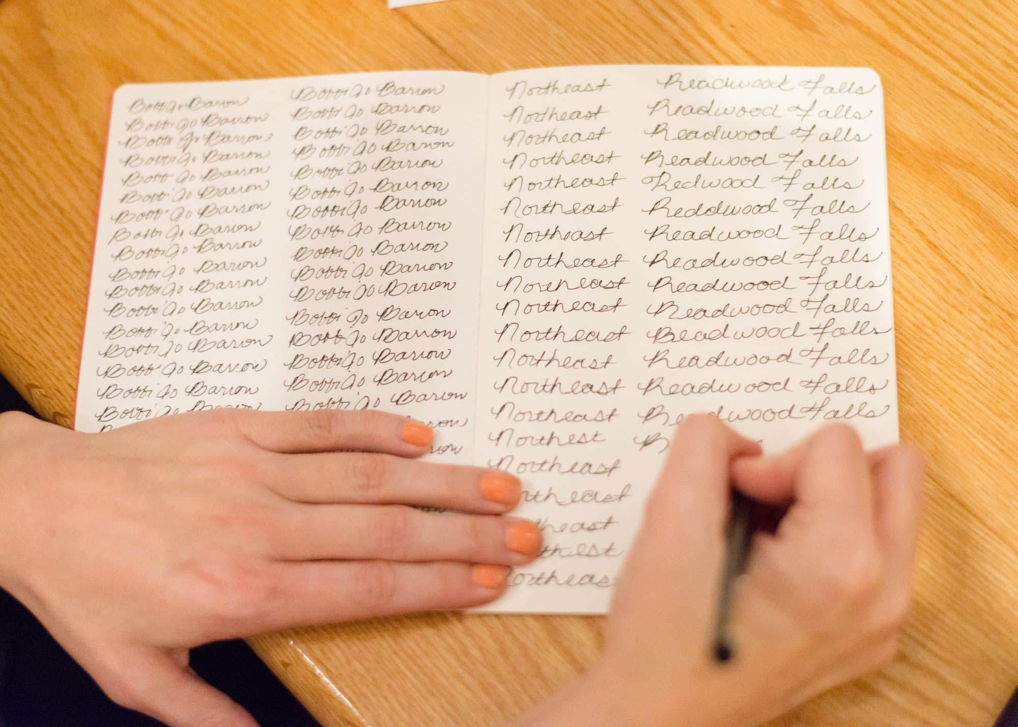 Bobbi Barron practices cursive handwriting.