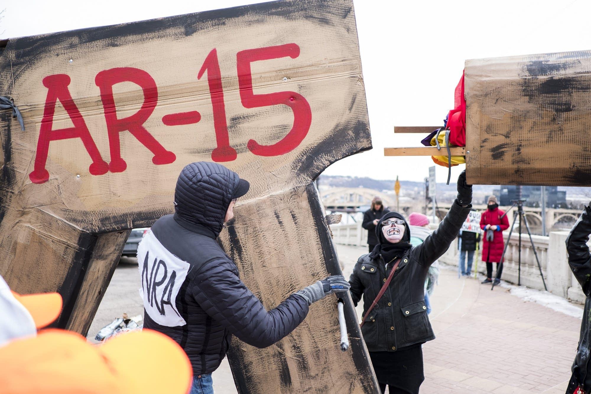 Member of Barebones Productions assemble a giant AR-15.