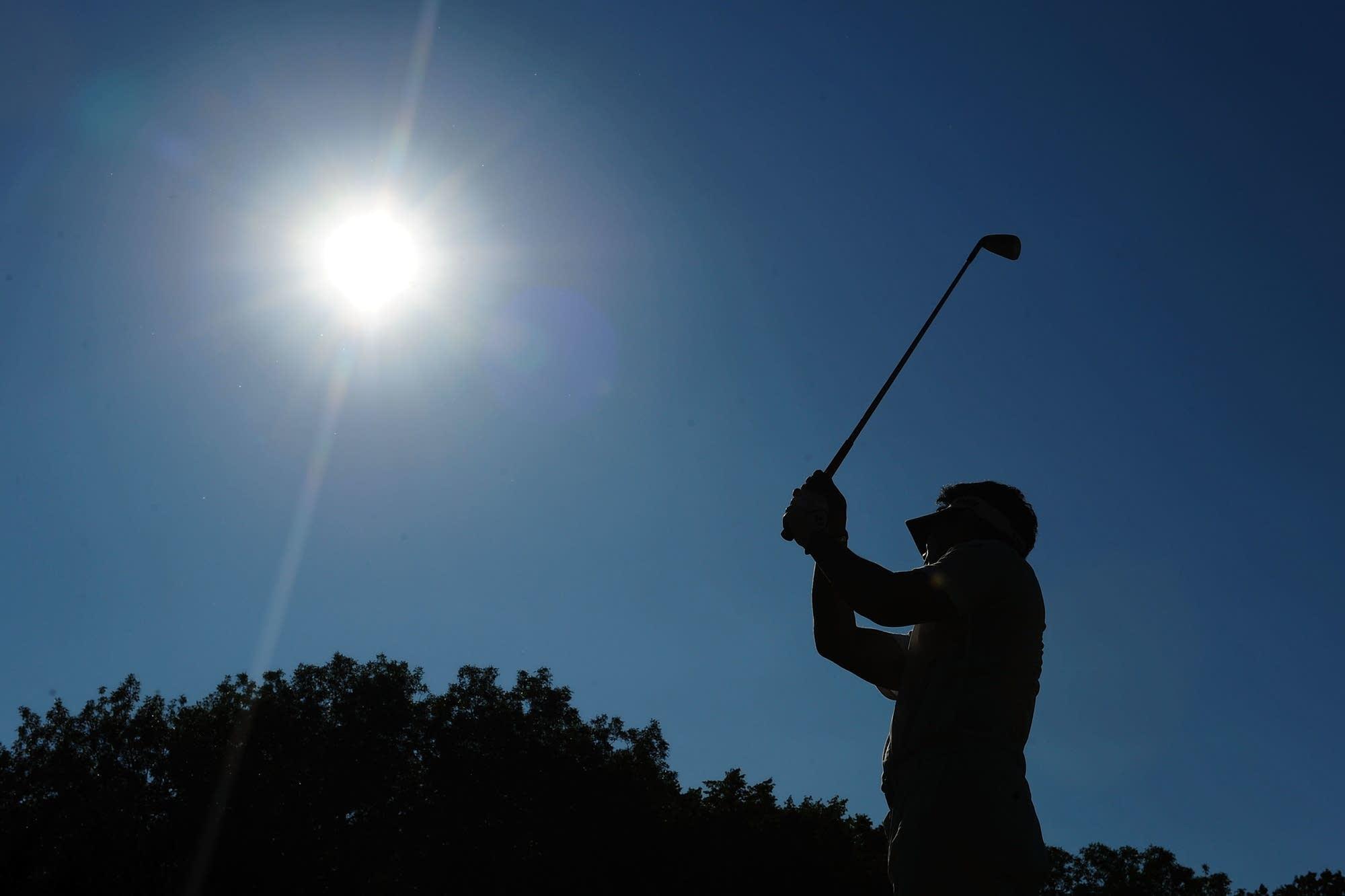Y.E. Yang plays his tee shot at Hazeltine National Golf Club.