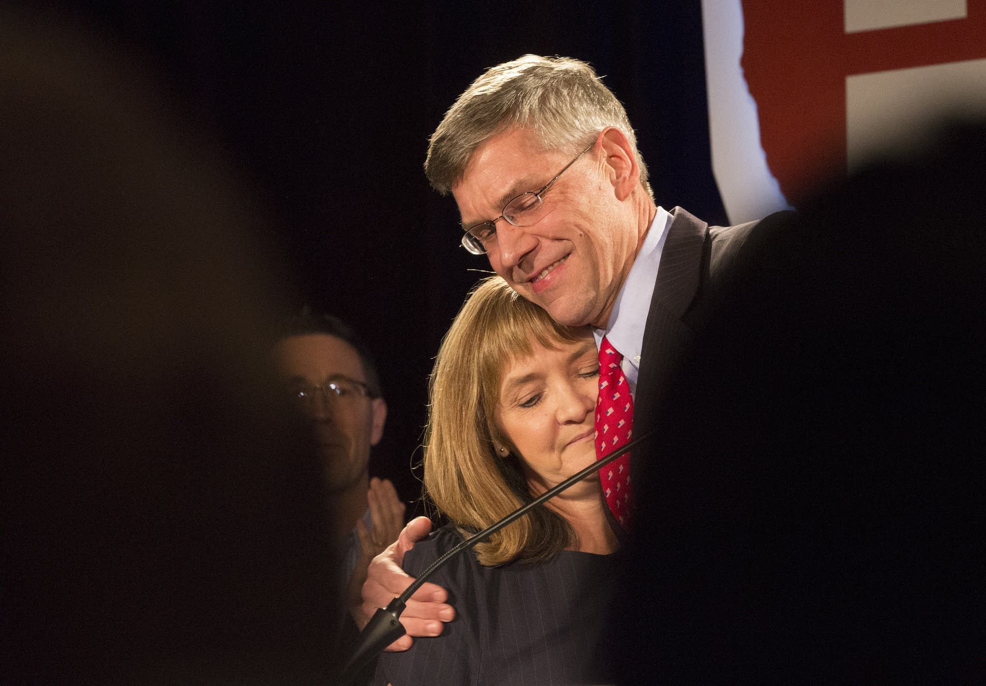Eric Paulson hugged his wife, Kelly, after conceding defeat.