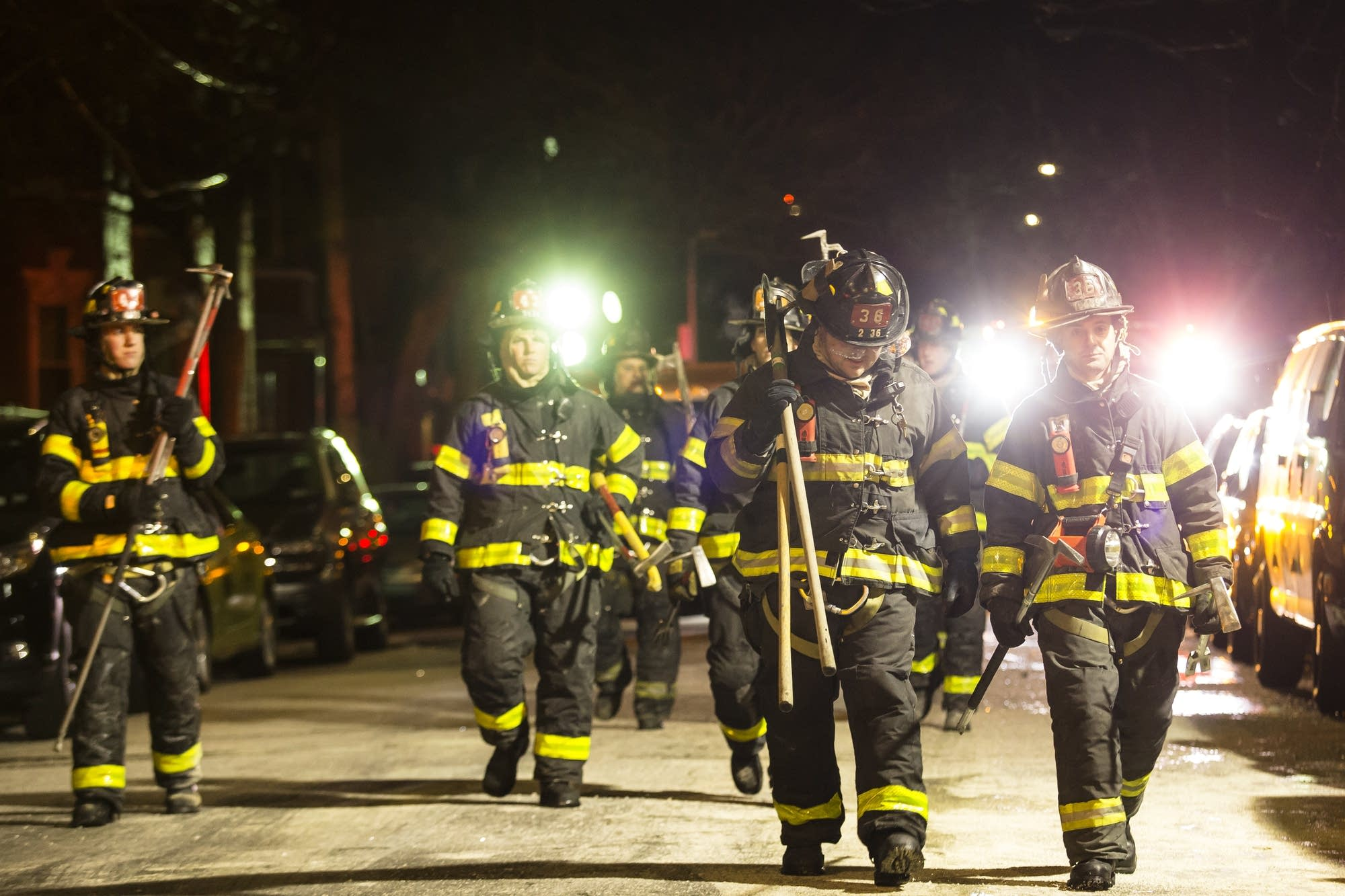 Firefighters leave after putting out a major house fire