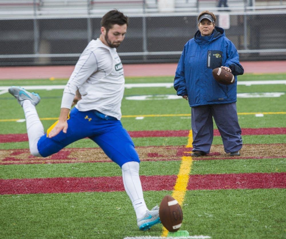 Maurer runs kicker through drills.