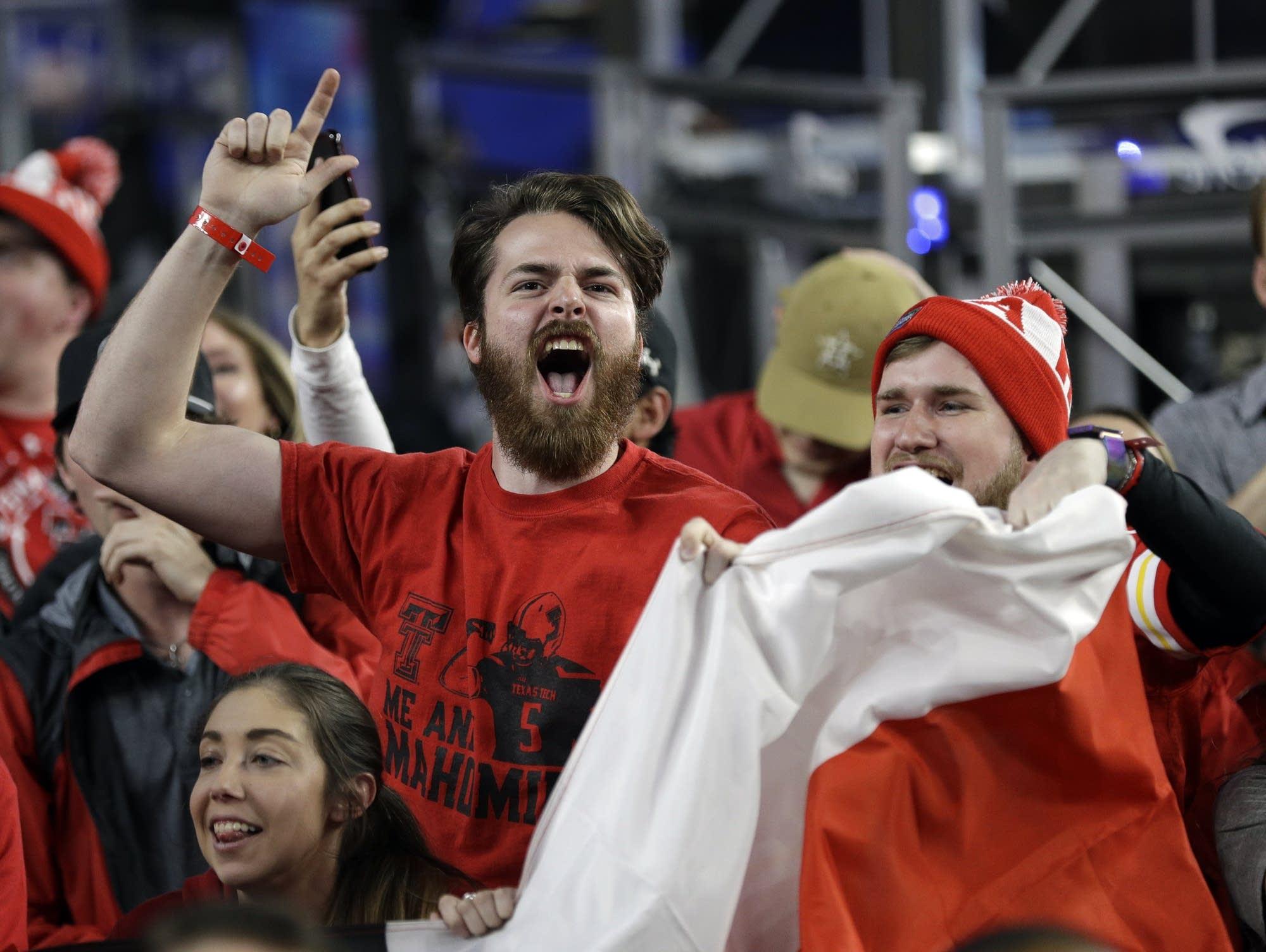 Texas Tech fans cheer before their team's Final Four semifinal
