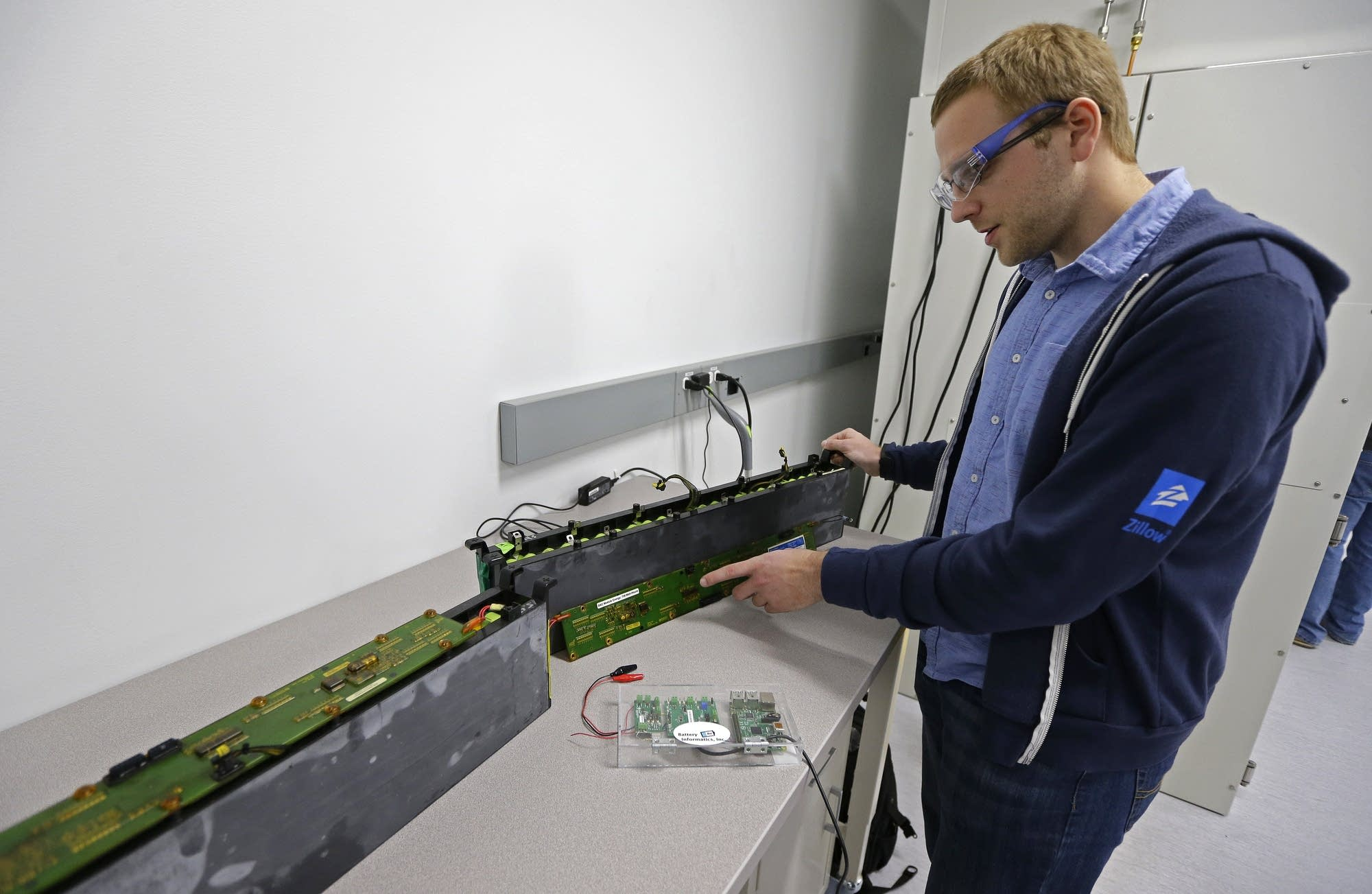 A PhD student holds a used lithium-ion battery