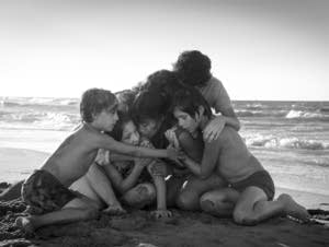 Yalitza Aparicio, center, in a scene from the film 'Roma.'