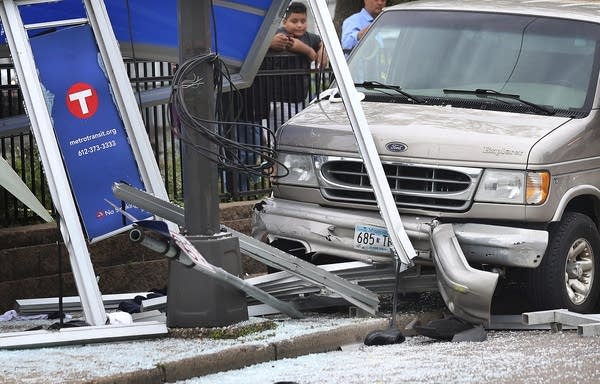 Six people were hurt when a van slammed into a crowded bus stop shelter.