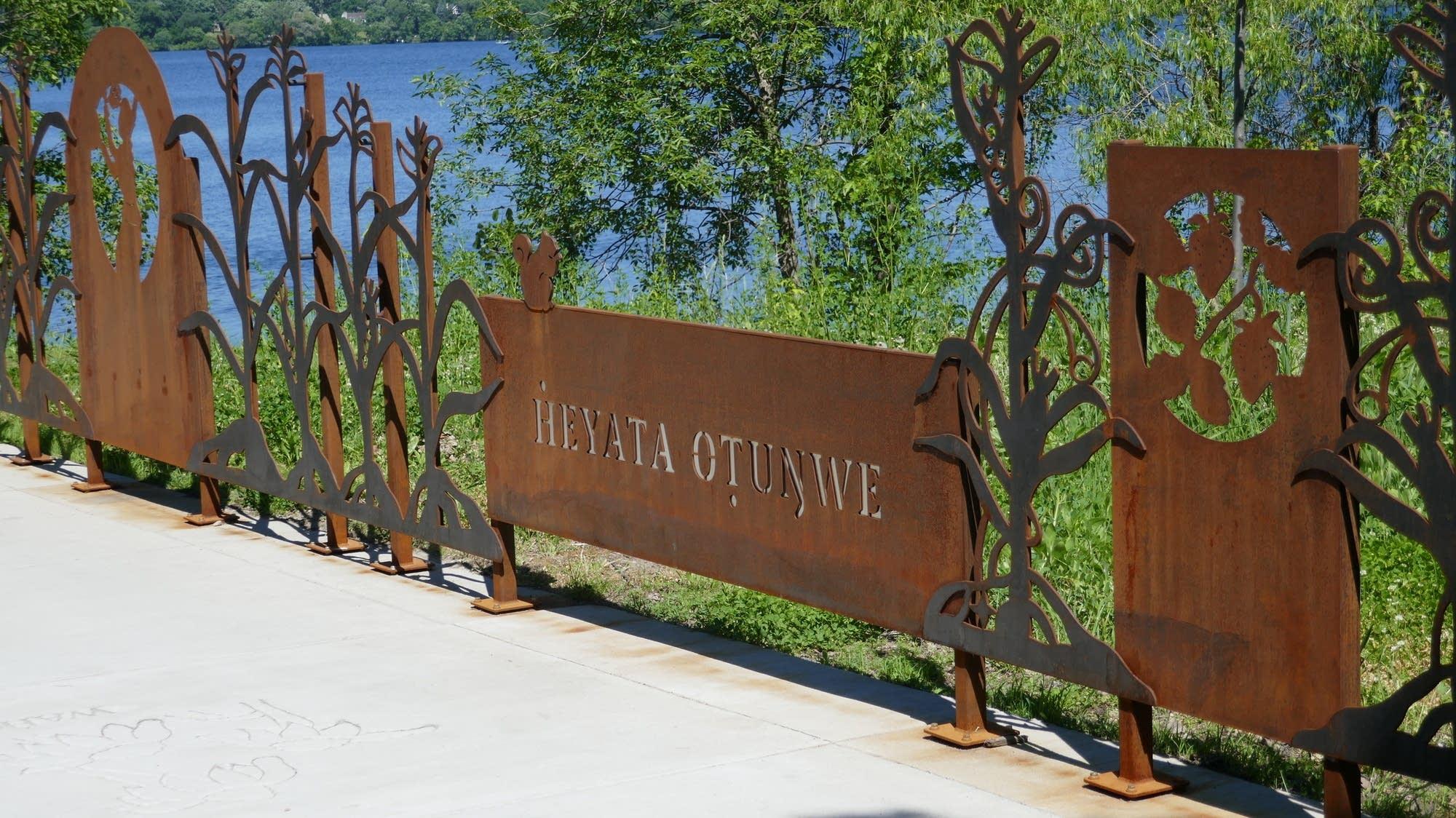 A decorative railing symbolizing generosity and farming