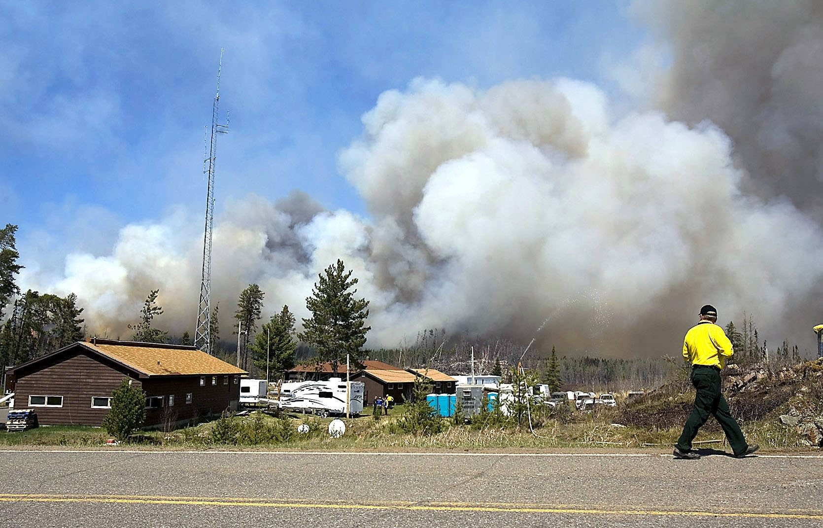 A wild land firefighter looks back at a portion of the fire in 2007.
