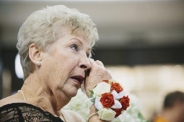 """Annette Runze, mother of Elizabeth """"Bethy"""" Weinlick wipes a tear."""