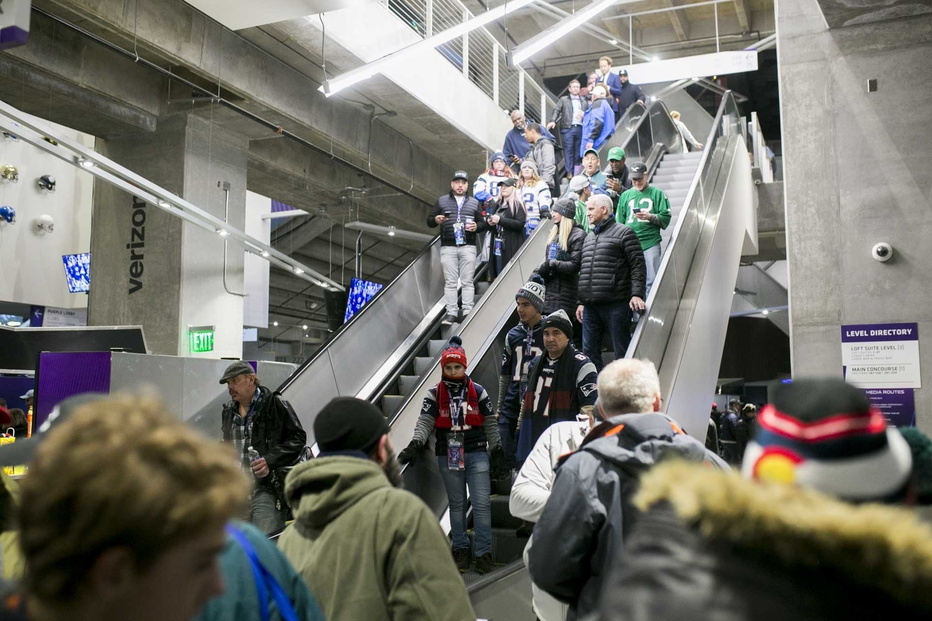New England and Philadelphia fans descend escalators
