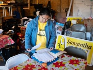 Samantha Vang reviews lists of addresses