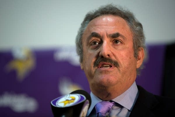 Vikings owner Zygi Wilf talks to reporters