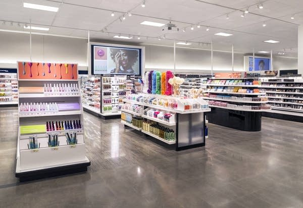 Merchandise is displayed in 'shops' throughout the store.