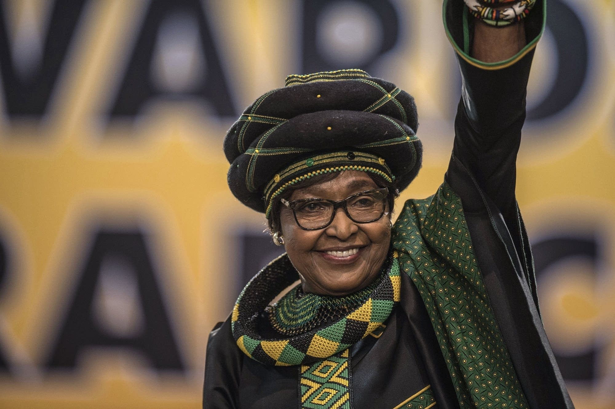 Winnie Mandela waves as she attends the 54th ANC National Conference.