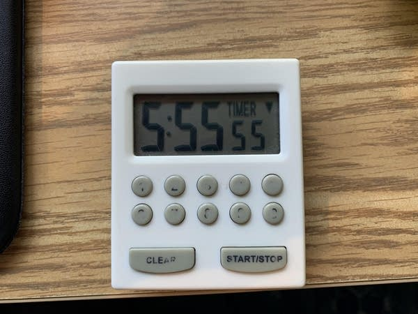 A small digital clock reads 5:55:55