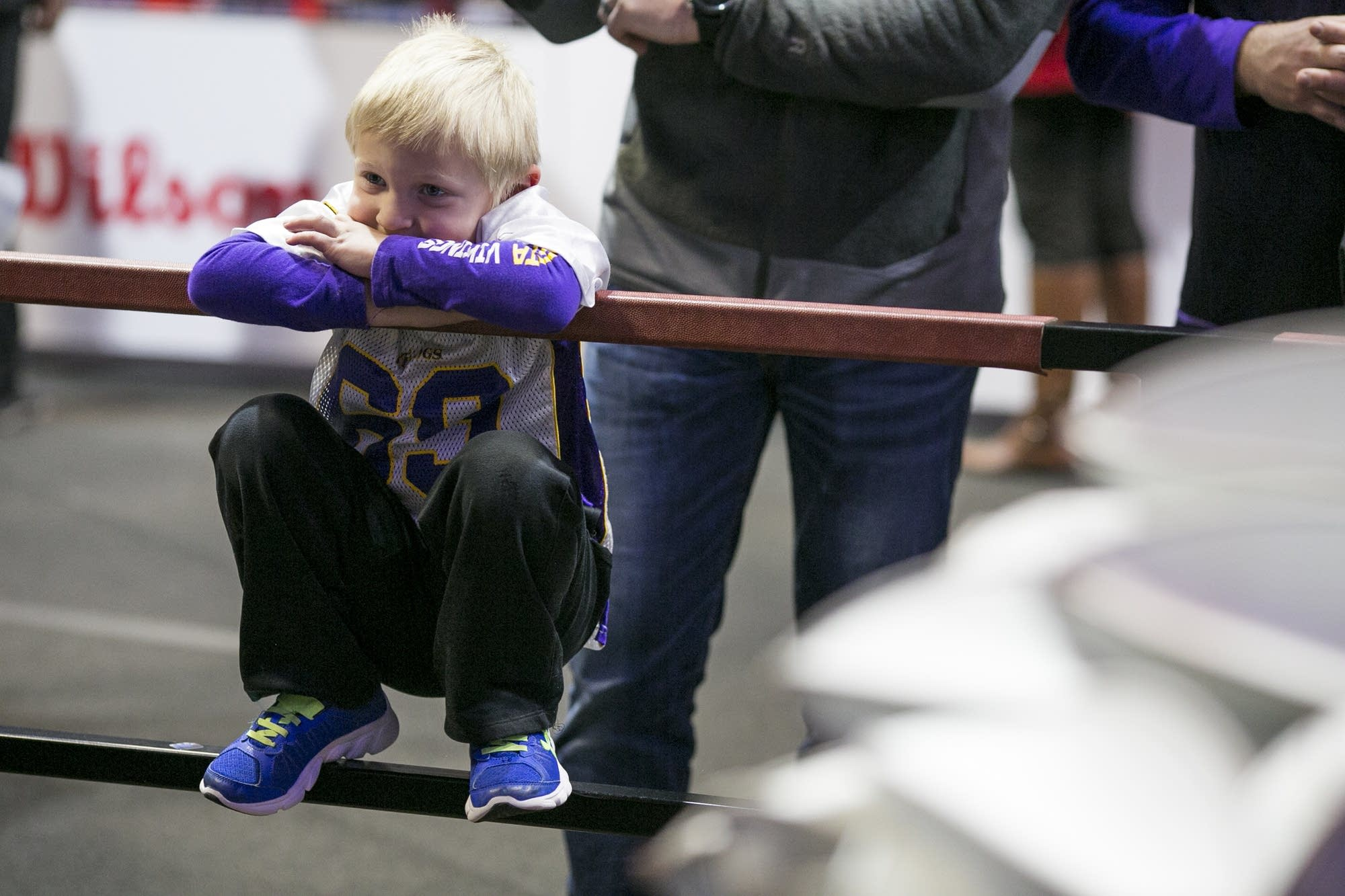 Five-year-old Zachary watches a football get made.