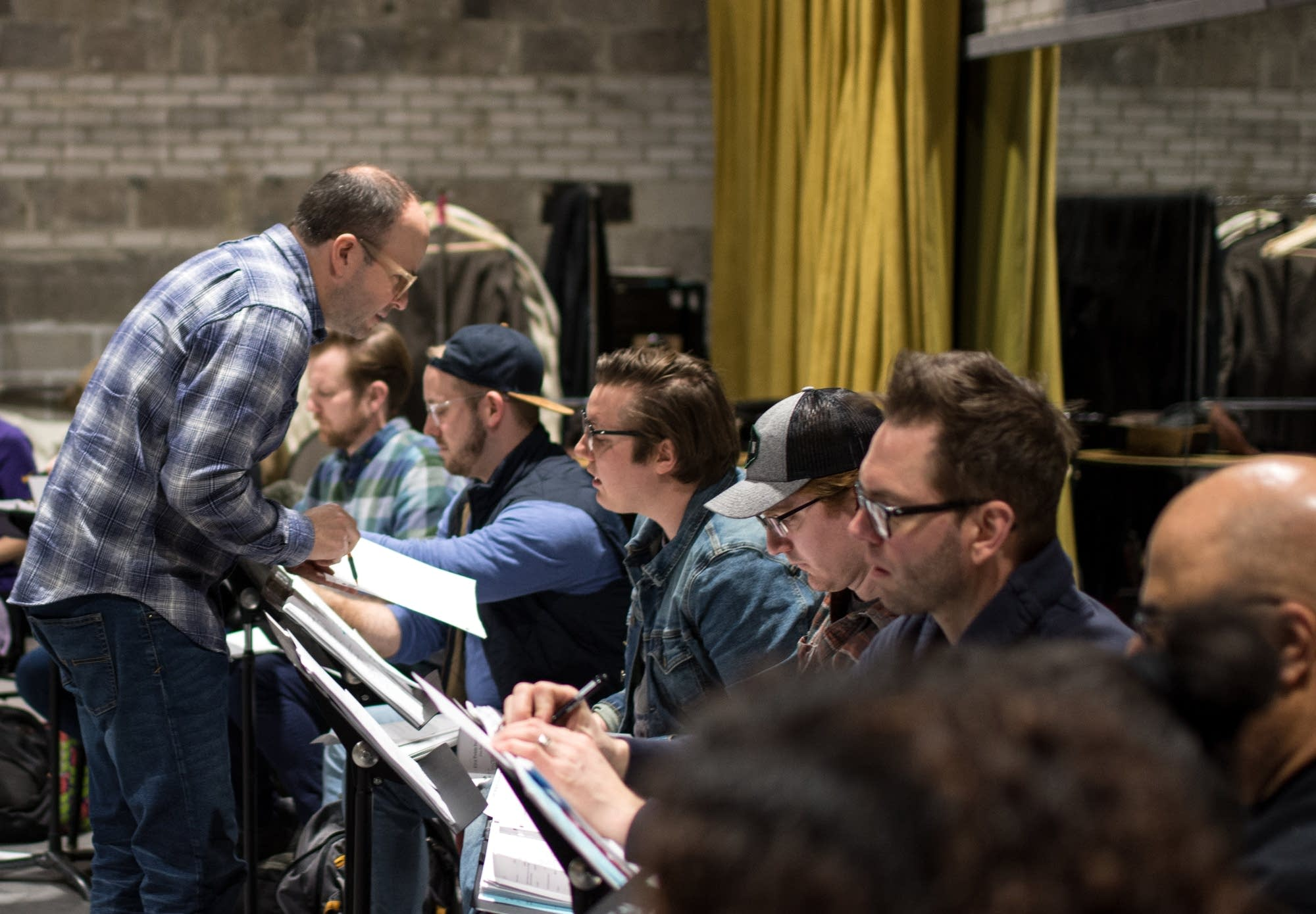 "Artistic Director Peter Rothstein works with the cast of ""Five Points."""