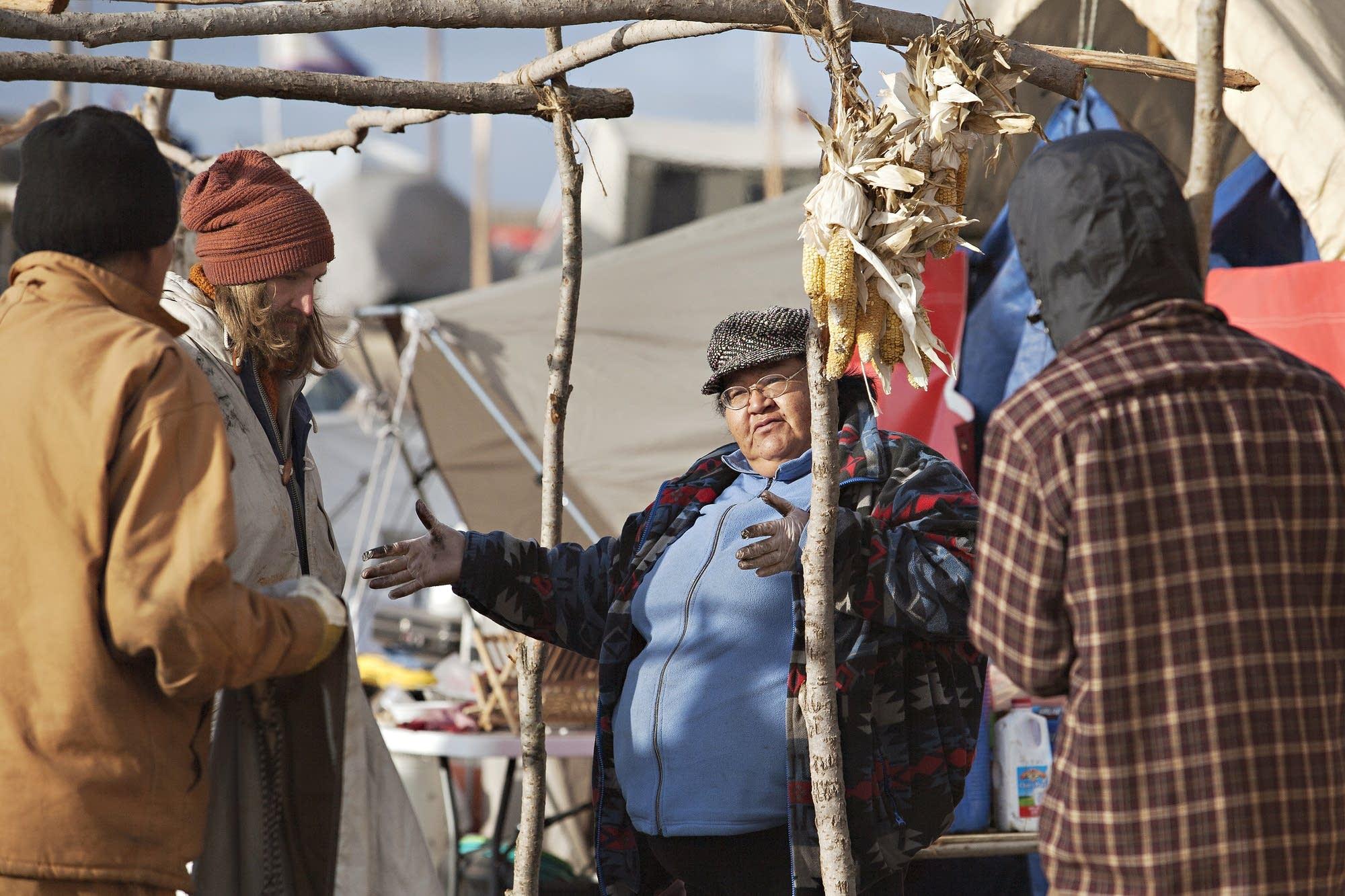 Cook Winona Kasto talks with volunteers.