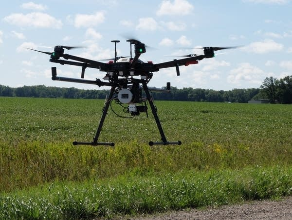 A drone lifts off for a data collection flight