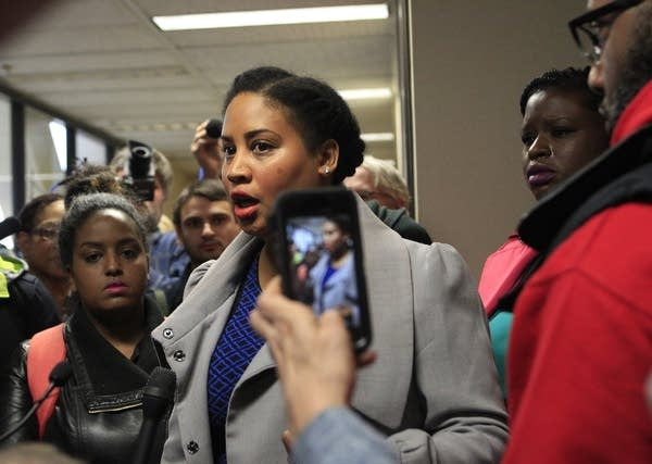 Raeisha Williams talks with reporters.
