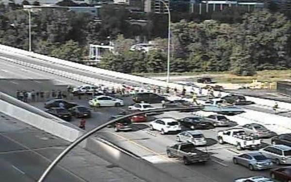 Protesters shut down I-35W