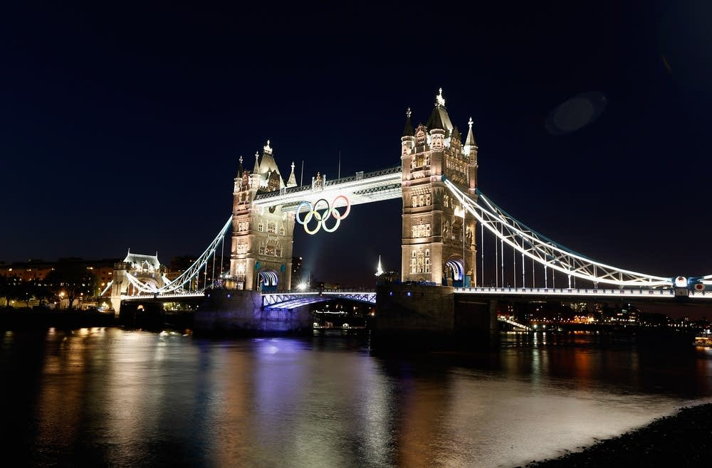 The Olympic rings hang from Tower Bridge