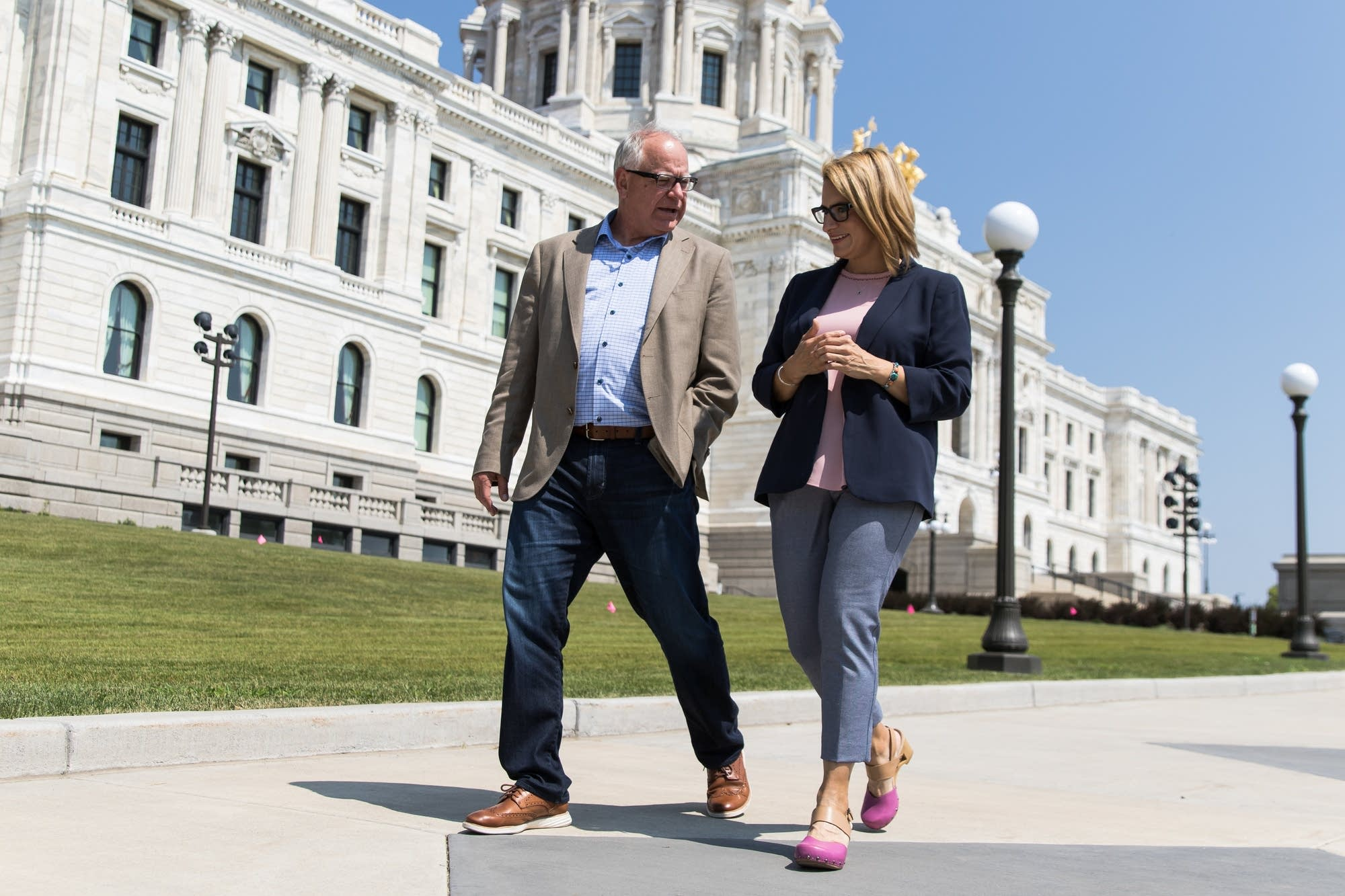 Tim Walz makes his way to the State Office Building with Peggy Flanagan.
