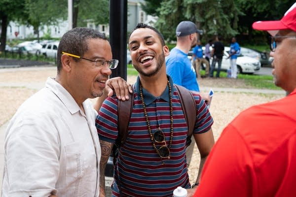 Keith Ellison greets Minneapolis City Council Member Phillipe Cunningham.
