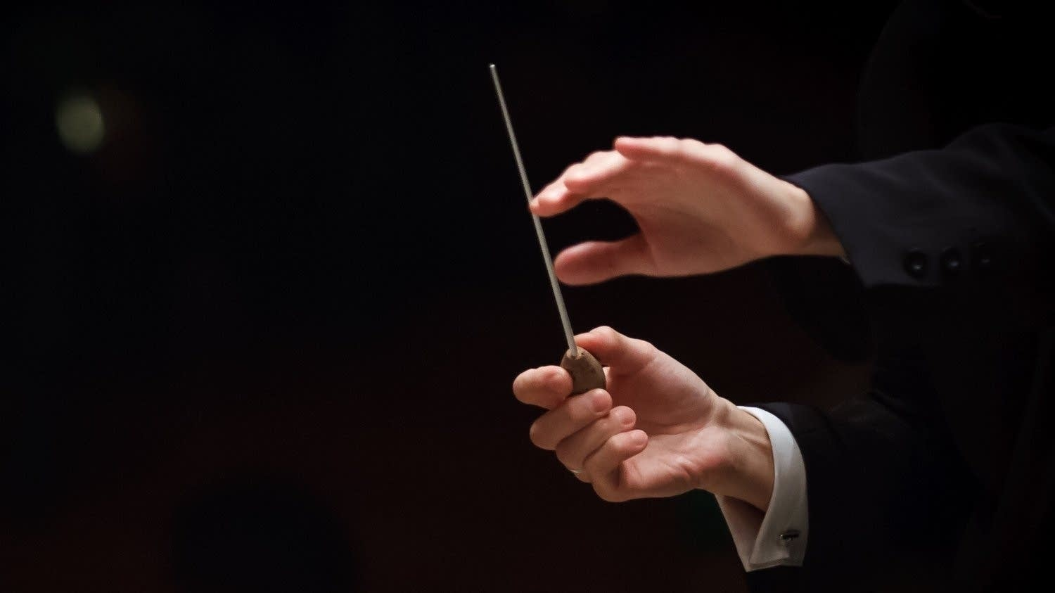 Conductor's hand with baton