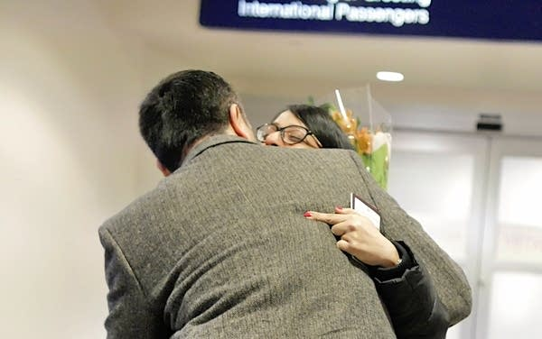 Farshid Zadeh hugs his wife Samaneh Raghimi as she arrived from Iran.