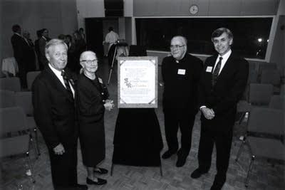 Sarah-Maud and Bob Sivertson, with Fr. Colman and Bill Kling