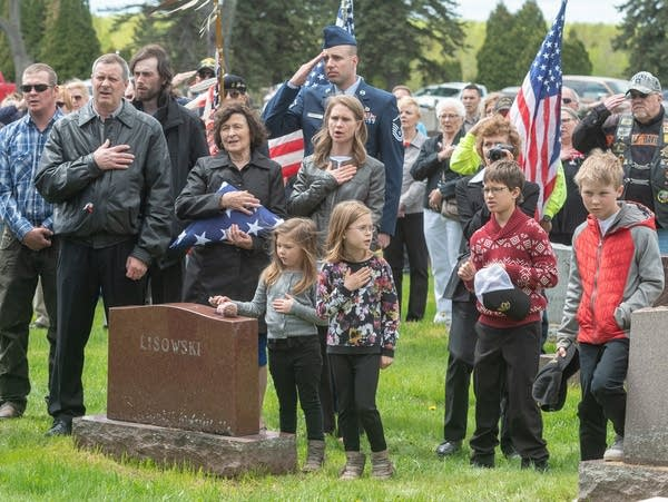 Family and community members attending the burial of Dante Tini
