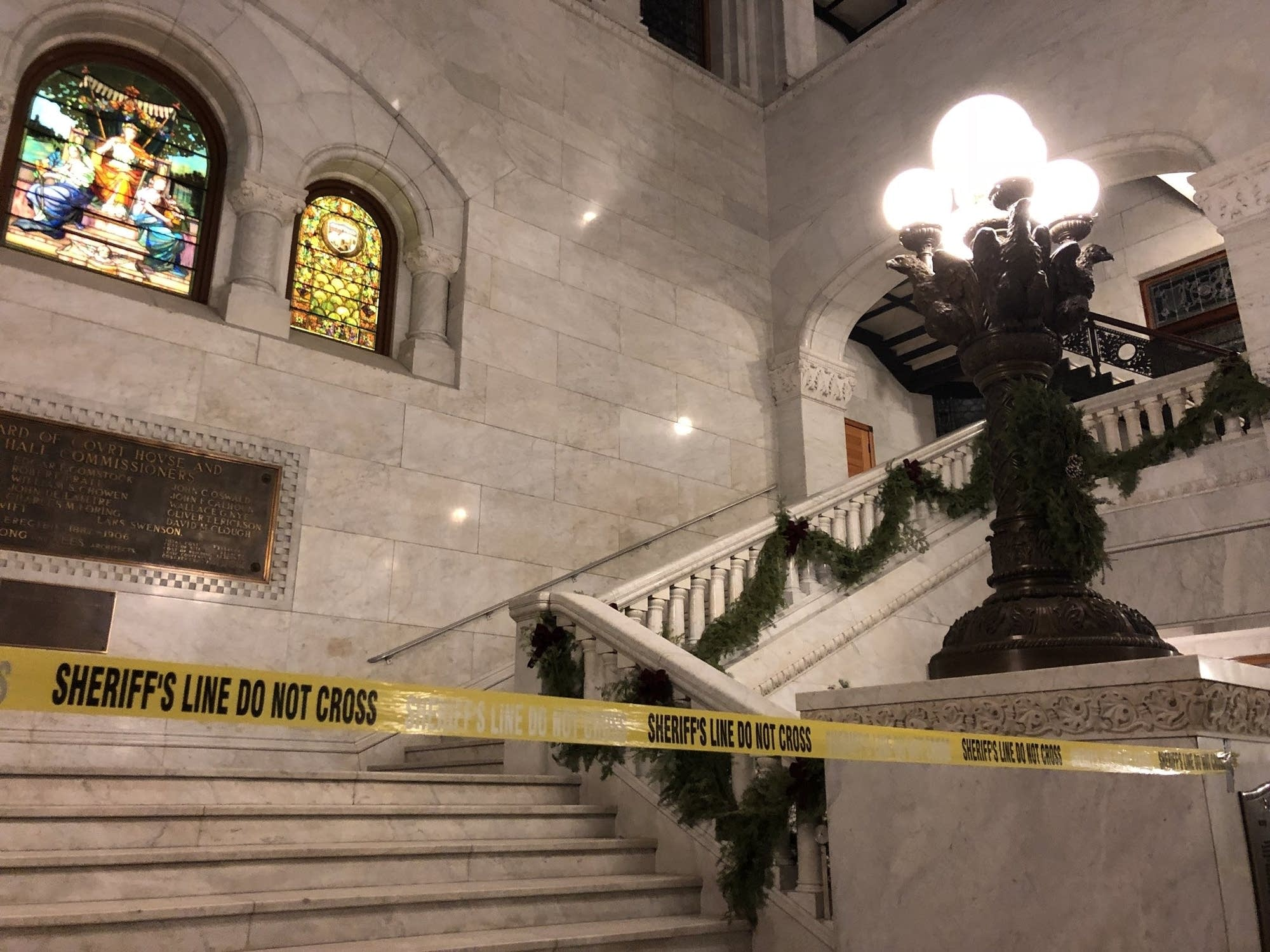 Sheriff's tape blocks off a staircase at City Hall