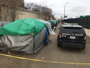 Police tape blocks off the south end of the homeless encampment.